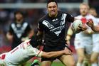 Jonny Lomax of England tackles Jordan Rapana of New Zealand Kiwis. Photo / Getty Images.