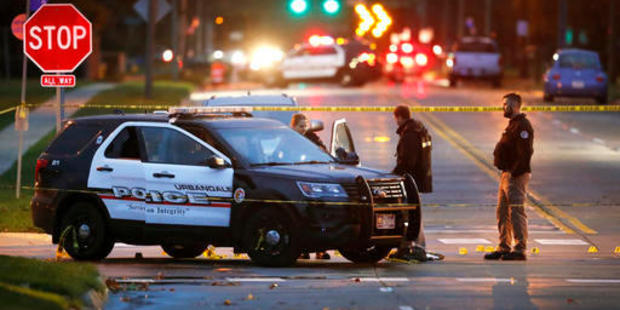 Police at the scene of a police shooting in Urbandale, Iowa. Photo / AP