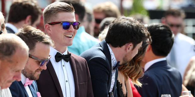 Callum Massie (C) at Melbourne Cup Day at Ellerslie Racecourse. Photo / Fiona Goodall/Getty Images