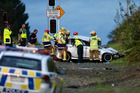 Emergency services attend a crash on the Puhinui Road on-ramp to the South-Western Motorway. Photo / Nick Reed