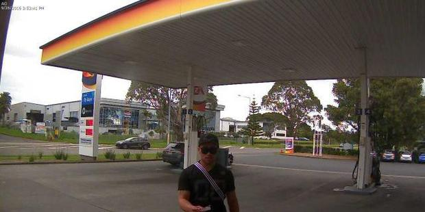 One of the alleged offenders pictured at a petrol station in Wiri, South Auckland. The victim's car is pictured in the background. Photo / police