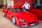 Senior sales executive Robert Pegg with the $1.6m Ferrari F40.  Phoro / Jason Oxenham
