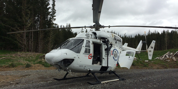The Palmerston North Rescue Helicopter lands near the site of a logging accident in the Waimarino Forest. PHOTO/ SUPPLIED