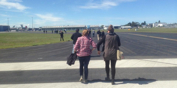Passengers evacuate from the aircraft. Photo / Supplied