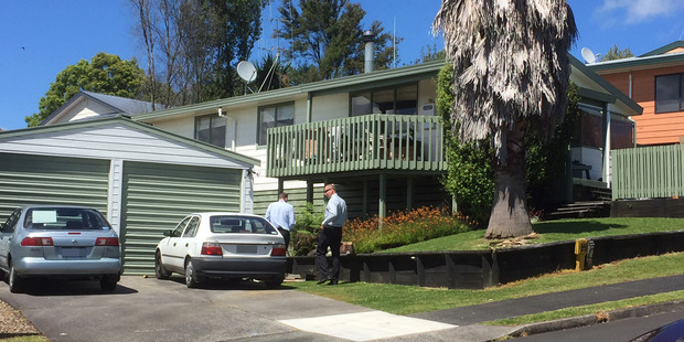 Hamilton detectives at the property of a man who died after a 'family harm incident' on Saturday. Photo / Belinda Feek