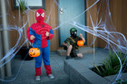 Megan Purcell, 4, and Caleb Purcell, 7, work their way through a web  during the Hobsonville Point Halloween Spooky Sunday. Photo / Dean Purcell