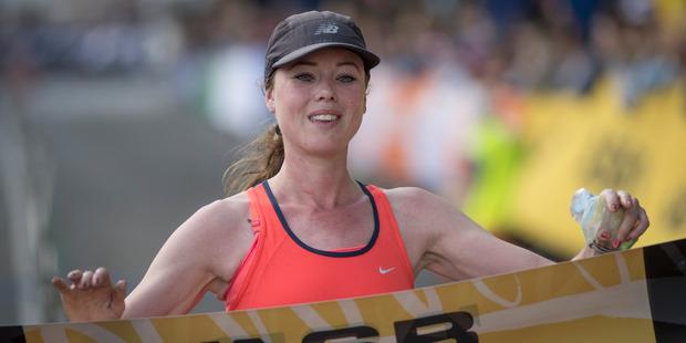 Nicole Goldsmid, celebrates winning the female marathon, Goldsmid joined 13,000 runners tackled the Auckland Marathon on Sunday in near perfect weather. Photo/Greg Bowker