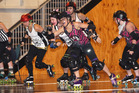 Rotorua's Motley Crew (pictured in purple and black) surged to an impressive Roller Derby victory on the weekend. PHOTO/BEN FRASER.