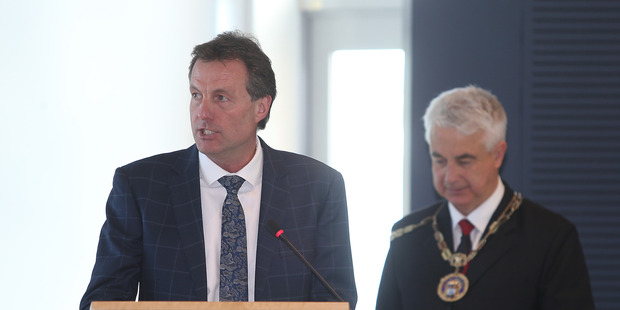 Loading Tauranga deputy mayor Kelvin Clout accepts the role handed to him from new mayor Greg Brownless, pictued in the background. Photo/John Borren