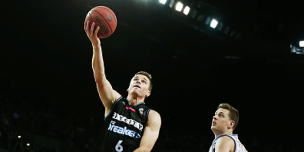 Kirk Penney scores against Daniel Johnson of Adelaide during the round four NBL match. Photo / Getty Images
