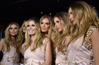 Model and television personality Heidi Klum, center, talks to the media with 'Heidi Clones' at her 17th Annual Halloween Party. Photo / AP