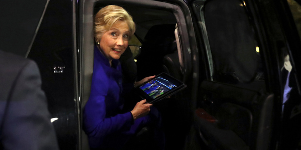 Democratic presidential candidate Hillary Clinton looks out of her vehicle as the Chicago Cubs win the World Series baseball Game 7. Photo / AP