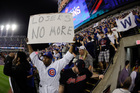 A fan with a 'Losers no more' poster reacts after the Chicago Cubs won Game 7 of the Major League Baseball World Series. Photo / AP