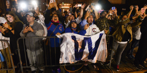 Chicago fans celebrate outside Wrigley Field. Photo/ Matt Marton Photosport