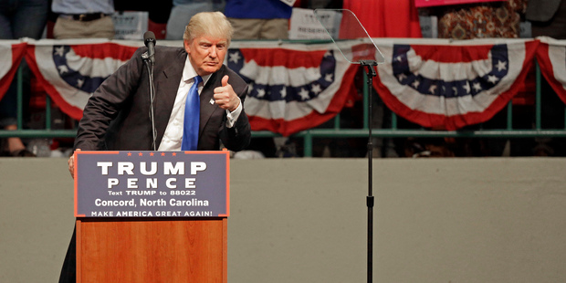 Donald Trump gestures as he speaks during a campaign rally. Photo / AP