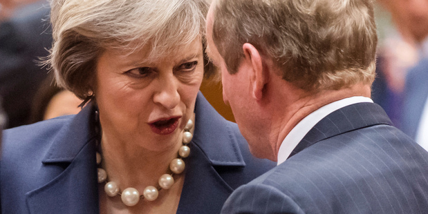 British Prime Minister Theresa May talks with Irish Prime Minister Enda Kenny during an EU summit in Brussels on  October 20. Photo / AP
