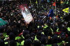 South Korean protesters are blocked by police officers after a rally calling for President Park Geun-hye to step down in downtown Seoul. Photo / AP