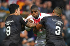 England's Jermaine McGillvary, centre, is tackled by New Zealand's Isaac Luke and Solomone Kata during their Four Nations match at the John Smith's Stadium in Huddersfield. Photo / AP.