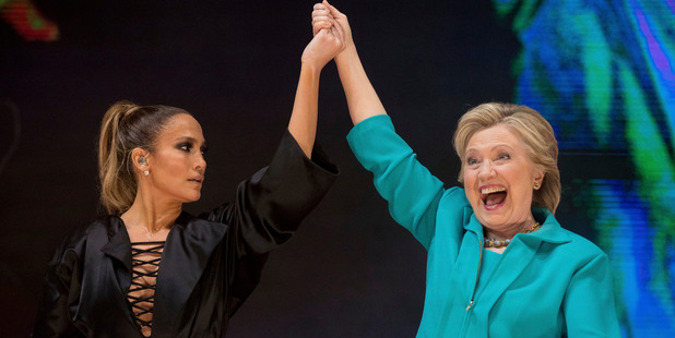 Hillary Clinton takes the stage with performer Jennifer Lopez at a Get Out The Vote performance in Miami. Photo / AP