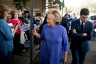Hillary Clinton greets supporters outside an early voting station. Photo / AP
