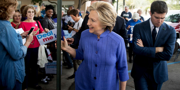 Loading Hillary Clinton greets supporters outside an early voting station. Photo / AP