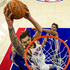 Oklahoma City Thunder's Steven Adams, center, goes up for the dunk as Philadelphia 76ers' Jahlil Okafor, right, looks on during the second half of an NBA basketball game. Photo / AP