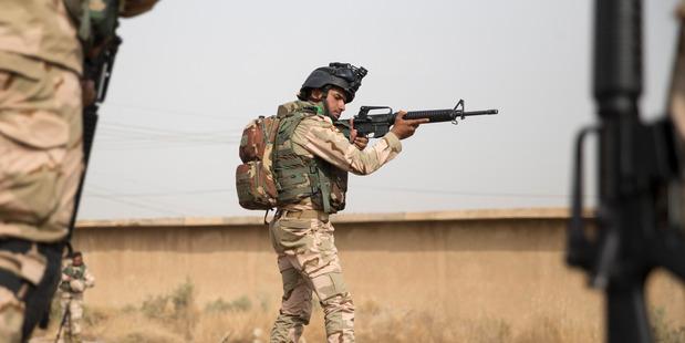 An Iraqi troop in a training sessions at Camp Taji. Photo / Mike Scott