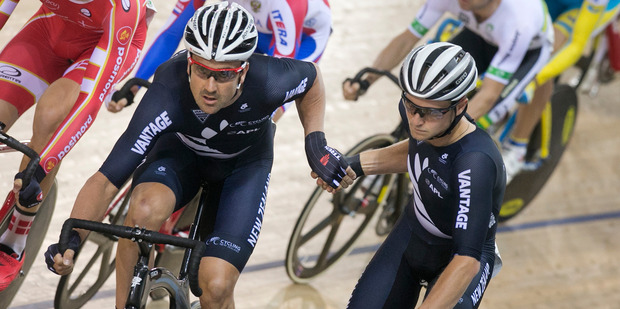 NEEDED BOOST: Hawke's Bay cyclist Regan Gough gives team mate Hayden Roulston a hand during the men's Madison race at the UCI World Cup track cycling event in Cambridge last year. PHOTO/FILE