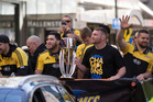 Hurricanes players with the Super Rugby trophy during their victory parade in Wellington in August. Photo/ Mark Mitchell