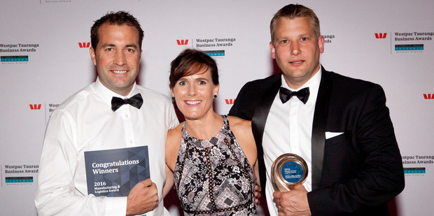 Winners: David Littlewood and Adam Hazlett from Modern Office and Office Furniture Warehouse with Cooney Lees Morgan's Mary Hill at the Westpac Tauranga awards. Photo/Andrew Warner