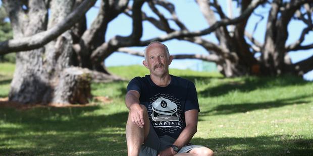 Gareth Morgan relaxing at Mt Drury, near his home at Mount Maunganui. Photo / John Borren