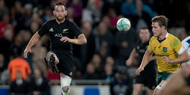 The AIG logo is prominent on AB jerseys, as shown by Aaron Cruden. Photo / Dean Purcell