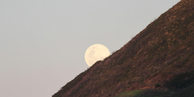 2014's supermoon rises over Ahipara, Northland. Photo / File