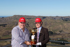 UP FOR GRABS: Hawke's Bay Racing CEO Andrew Castles (left) with one of the Melbourne Cup callers Bryan Martin pictured with the Cup on Te Mata Peak earlier in the year.