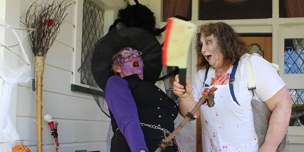 Vicky Grace, left, from Auckland and her scary friend at Maree Foster's haunted house on Victoria Ave on Saturday. Photo / Christine McKay