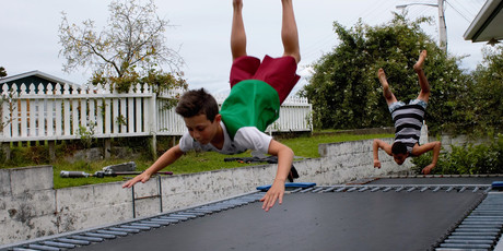 FLYING BOYS: Finley Stanelun, 11 (foreground), and Max Prizgintas, 12, flip in unison outside Max's house in Otumoetai. Photo/Dawn Picken