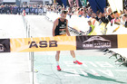 Oska Inkster-Baynes crossed the finish line to win the ASB Auckland Marathon. Photo / Getty Images.