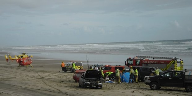 Paramedics attend to injured motorists on Baylys Beach after a two-car crash on Saturday.