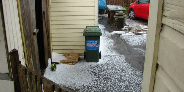 Hail fell on Onerahi yesterday leaving gardens and yards with a deep white coating. Photo/Supplied