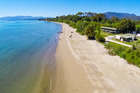 A slice of paradise is up for grabs with the sale of Golden Bay Kiwi Holiday Park and riparian rights to Tukurua Beach. Photo / Bayleys