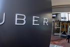 Uber says it has no way of knowing who is telling the truth about who left the bottles in the taxi. Photo / AP