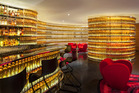 The Watergate Hotel's Next Whisky Bar boasts a curved wall of 2500 illuminated bottles. Photo / Ron Blunt
