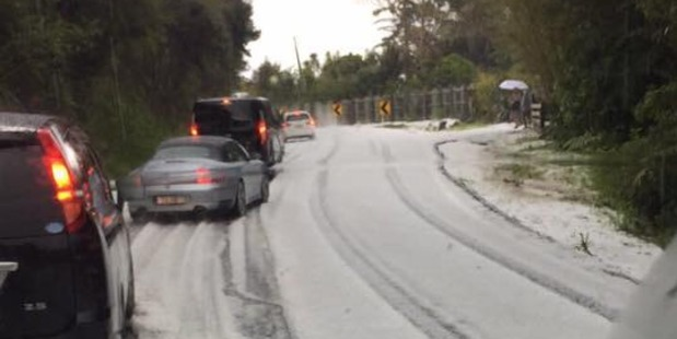 Loading Hail slows traffic in the Waitakeres. Photo / Sam Spence