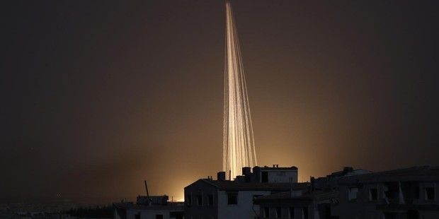 Phosphorus bombs explode over Aleppo, Syria. Photo / AP