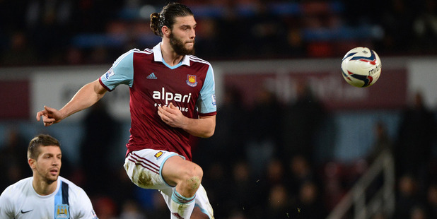 West Ham striker Carroll 'threatened by armed robbers'