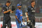 India's Amit Mishra, centre, carries a wicket as he leaves the ground with New Zealand's batsmen, Trent Boult, left, and Mitchell Santner. Photo / AP
