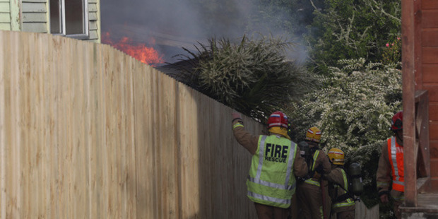 Firefighters at the scene. Photo / Greg Bowker