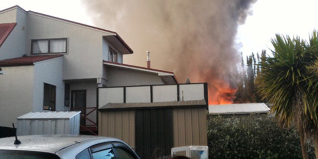 Loading Fire, police and ambulance are at the scene of the Fruitvale Rd property in New Lynn which was engulfed in fire. Photo / Supplied