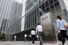 Pedestrians walk past signage for Sony Corp. outside the company's headquarters in Tokyo. Photo / Kiyoshi Ota / Bloomberg