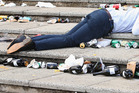 A fan has a lie down during the Melbourne Cup. Photo / Getty